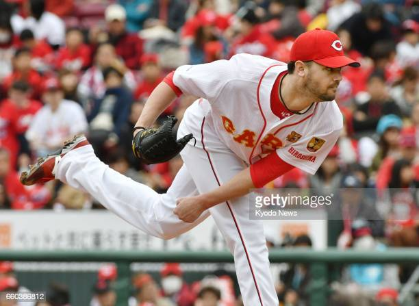 Kris Johnson of the Hiroshima Carp pitches in a preseason game against the Nippon Ham Fighters at Mazda Stadium in Hiroshima on March 18 2017 Having...