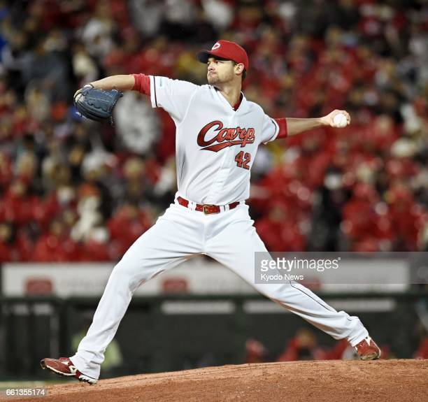 Kris Johnson pitches in the Hiroshima Carp's seasonopening game against the Hanshin Tigers at Mazda Stadium in Hiroshima on March 31 2017 ==Kyodo