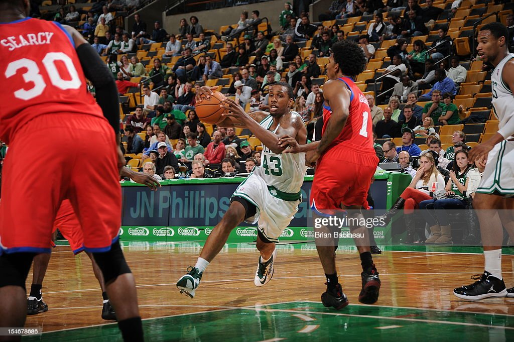 Kris Joseph #43 of the Boston Celtics drives to the basket against Nick Young #1 of the Philadelphia 76ers on October 21, 2012 at the TD Garden in Boston, Massachusetts.