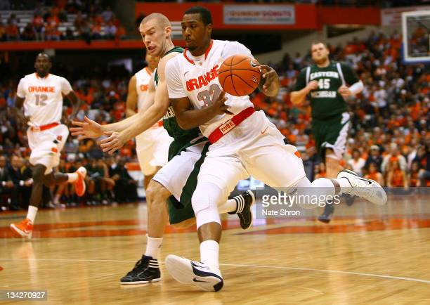 Kris Joseph of the Syracuse Orange drives to the basket against Austin Harper of the Eastern Michigan Eagles during the game at the Carrier Dome on...