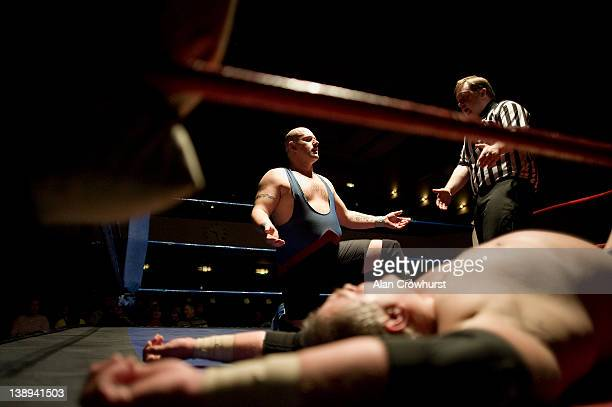 Kris Kay chats with referee Chris Hatch as Flash Barker lays flat out on the cancas at The Assembly Hall on February 13 2012 in Worthing England