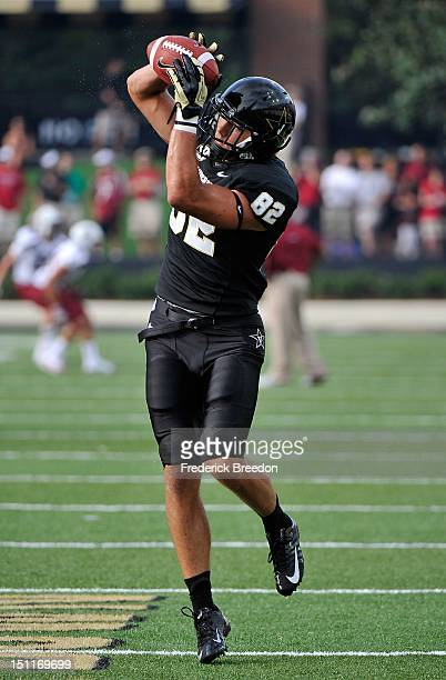 Kris Kentera of the Vanderbilt Commodores warms up prior to a game against the South Carolina Gamecocks at Vanderbilt Stadium on August 30, 2012 in...
