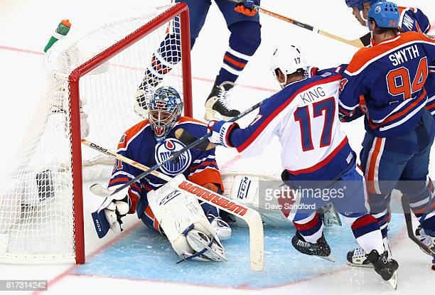 Kris King of the Winnipeg Jets alumni scores against goaltender Curtis Joseph of the Edmonton Oilers alumni during the 2016 Tim Hortons NHL Heritage...