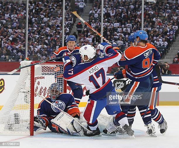Kris King of the Winnipeg Jets alumni scores on Curtis Joseph of the Edmonton Oilers alumni during the 2016 Tim Hortons NHL Heritage Classic alumni...