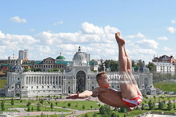 Kris Kolanus of Poland competes in the Men's High Diving 27m preliminary round on day ten of the 16th FINA World Championships at the Kazanka River...