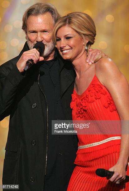 Kris Kristofferson and Faith Hill appear on stage at the 38th Annual CMA Awards at the Grand Ole Opry House November 9 2004 in Nashville Tennessee