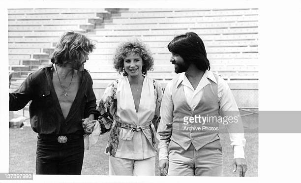 Kris Kristofferson Barbra Streisand and Jon Peters are on location in Sun Devil Stadium for the filming of 'A Star Is Born' 1976