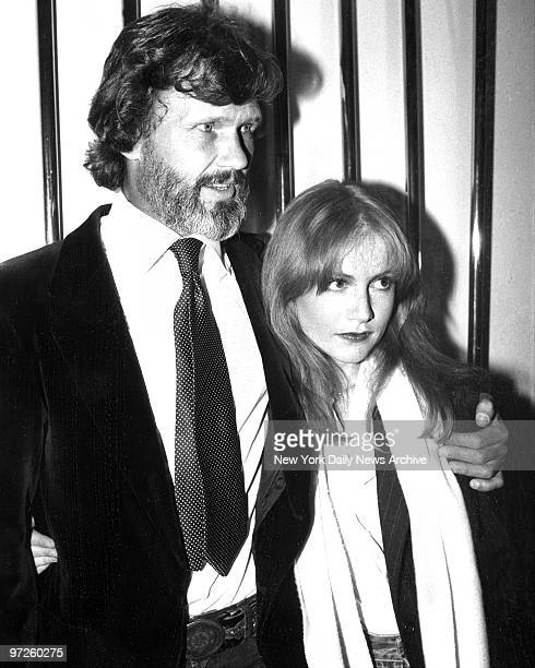 """Kris Kristofferson escorts his co-star Isabelle Huppert to the opening of their new movie """"Heaven's Gate""""."""