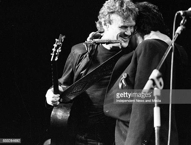 Kris Kristofferson performing with U2's Bono at the Olympia Theatre Dublin