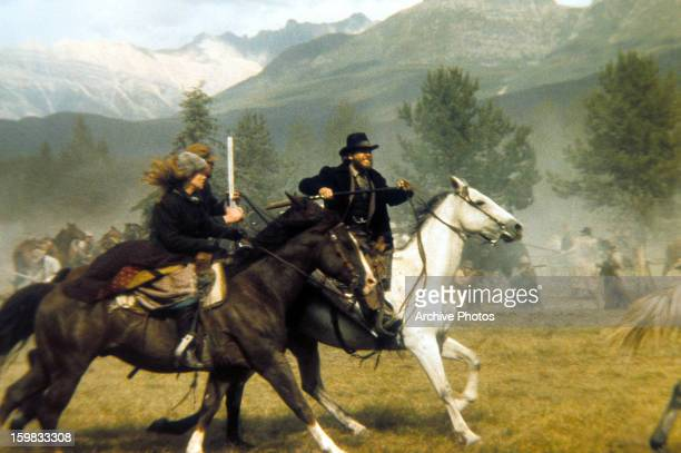 Kris Kristofferson rides horses with several others in a scene from the film 'Heaven's Gate' 1980