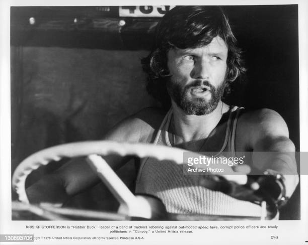Kris Kristofferson takes the wheel in a scene from the film 'Convoy', 1978.