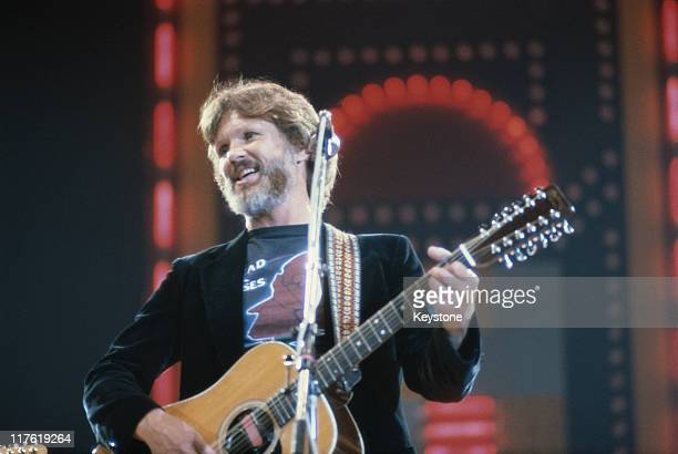 Kris Kristofferson US country singer and actor playing the guitar on stage during a live concert performance at the International Festival of Country...