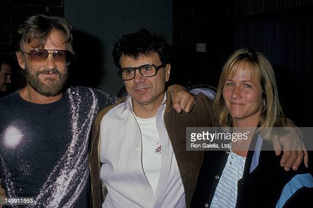 Kris Kristofferson wife Lisa Meyers and Robert Blake attend the screening of Cover Up Behind the IranContra Affair on June 24 1988 at the Director's...