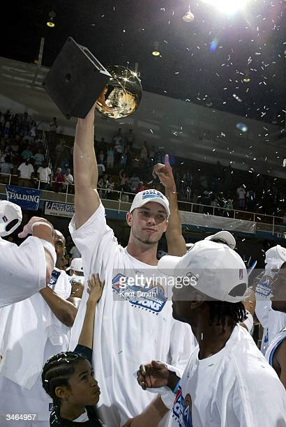 Kris Lang of Asheville Altitude celebrates with the trophy after the win against the Huntsville Flight at the Asheville Civic Center on April 24 2004...