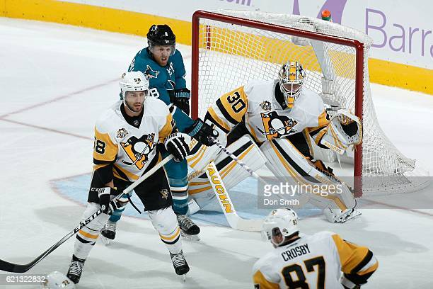 Kris Letang and Matthew Murray of the Pittsburgh Penguins defend the net against Joe Pavelski of the San Jose Sharks during a NHL game at SAP Center...