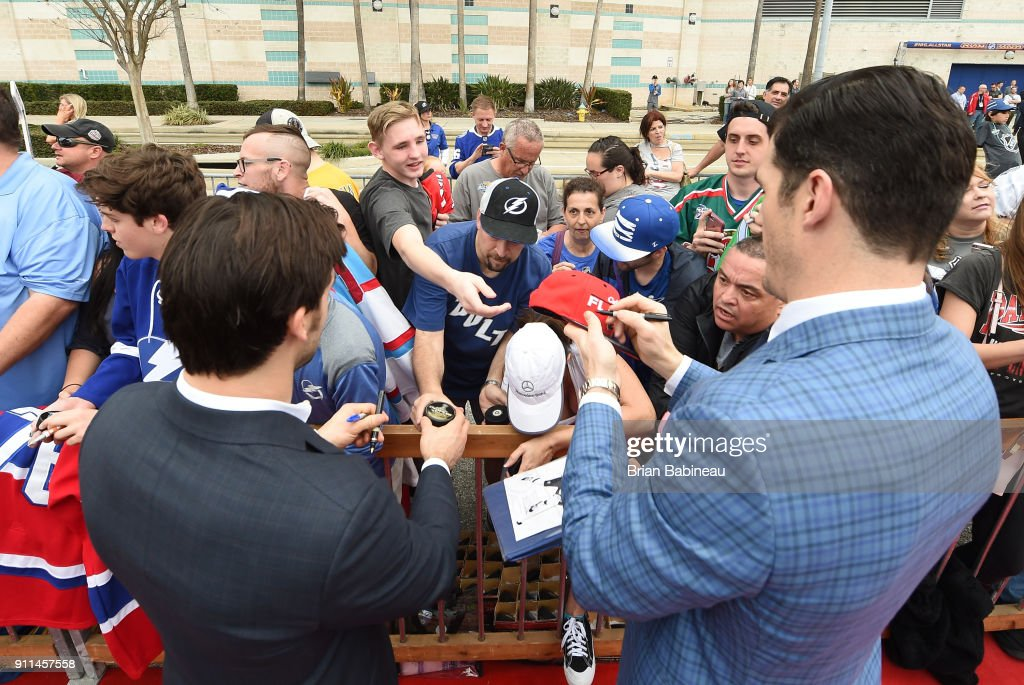 Kris Letang #58 of the Pittsburgh Penguins (L) and Brian Boyle #11 of the New Jersey Devils walk the red carpet prior to playing in the 2018 Honda NHL All-Star Game at Amalie Arena on January 28, 2018 in Tampa, Florida.