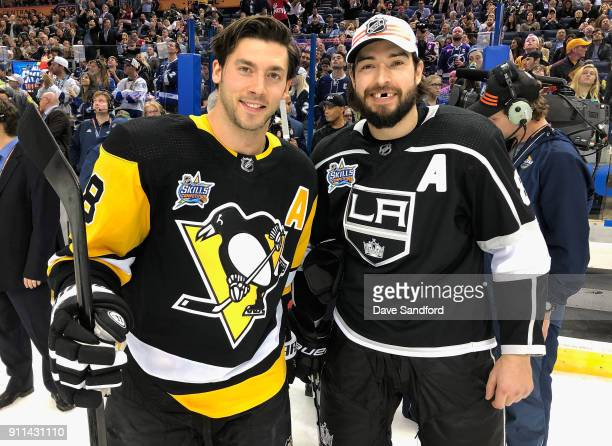 Kris Letang of the Pittsburgh Penguins and Drew Doughty of the Los Angeles Kings pose together after the 2018 GEICO NHL AllStar Skills Competition at...