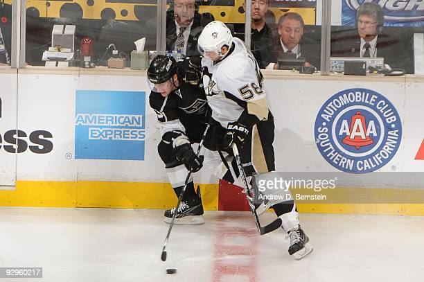 Kris Letang of the Pittsburgh Penguins battles for the puck against the Los Angeles Kings on November 5, 2009 at Staples Center in Los Angeles,...