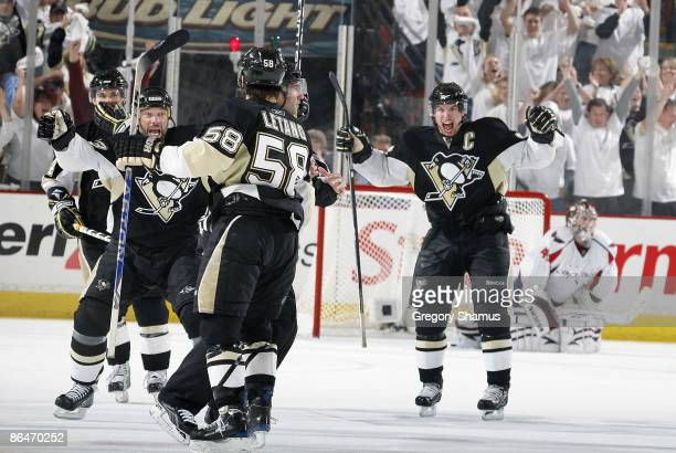 Kris Letang of the Pittsburgh Penguins celebrates his gamewinning goal with teammates against the Washington Capitals during Game Three of the...