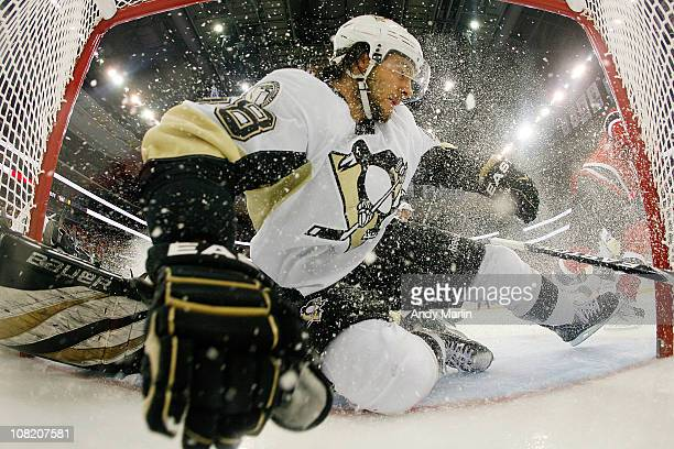 Kris Letang of the Pittsburgh Penguins goes sliding into the net during the game against of the New Jersey Devils at the Prudential Center on January...