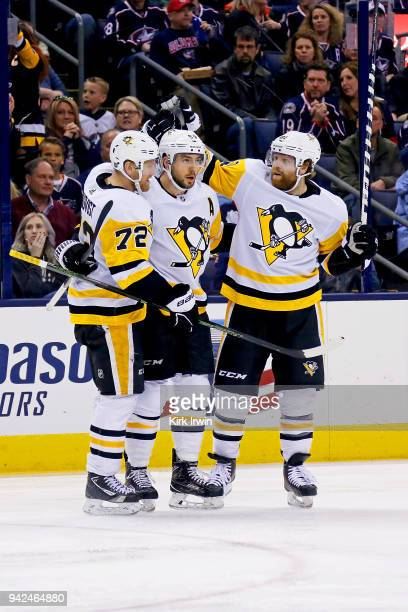 Kris Letang of the Pittsburgh Penguins is congratulated by Patric Hornqvist of the Pittsburgh Penguins and Phil Kessel of the Pittsburgh Penguins...