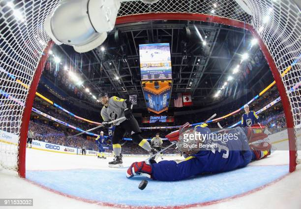 Kris Letang of the Pittsburgh Penguins scores on Carey Price of the Montreal Canadiens during the 2018 Honda NHL All-Star Game between the Atlantic...