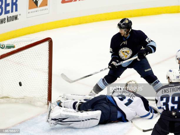 Kris Letang of the Pittsburgh Penguins scores past Ondrej Pavelec of the Winnipeg Jets during the game at Consol Energy Center on February 11, 2012...