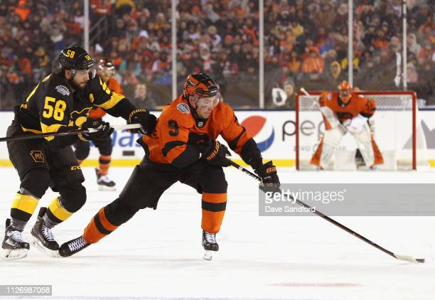 Kris Letang of the Pittsburgh Penguins skates after Ivan Provorov of the Philadelphia Flyers during the first period of the 2019 Coors Light NHL...