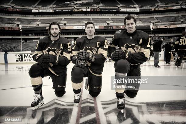 Kris Letang Sidney Crosby and Evgeni Malkin of the Pittsburgh Penguins pose for a photo prior to the 2019 Coors Light NHL Stadium Series game between...
