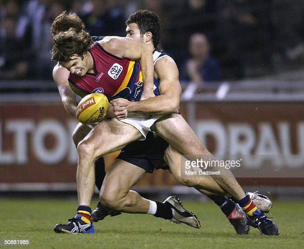 Kris Massie for the Crows is tackled by Chris Tarrant for the Magpies during the round nine AFL match between the Collingwood Magpies and the...