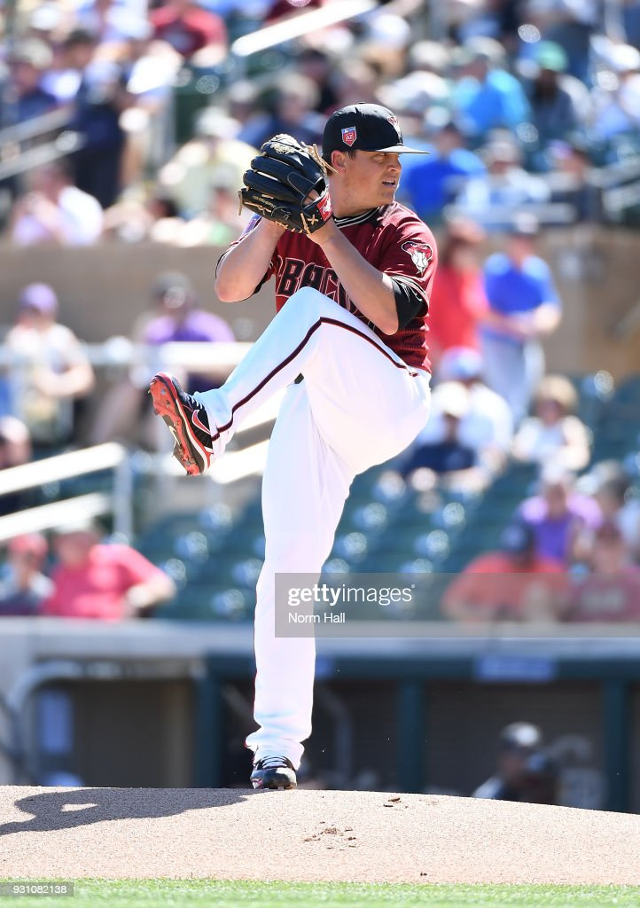 Kris Medlen #47 of the Arizona Diamondbacks delivers a first inning pitch during a spring training game against the Colorado Rockies at Salt River Fields at Talking Stick on March 12, 2018 in Scottsdale, Arizona.