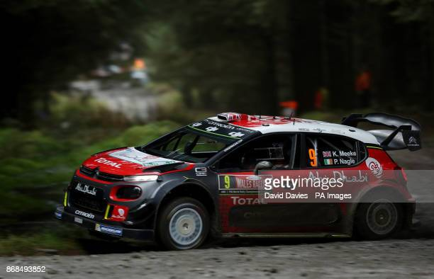 Kris Meeke of Great Britain and Citroen Total Abu Dhabi WRT drives with codriver Paul Nagle of Ireland during day four of the Dayinsure Wales Rally...