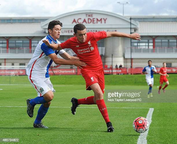 Kris Owens of Liverpool and Lewis Travis of Blackburn Rovers in action during the Liverpool v Blackburn Rovers U18 Premier League game at the...