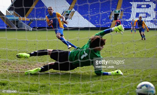 Kris Owens of West Derby beats Tom Easterbrook of Beechen Cliff to score from the penalty spot during the Premier League Schools Cup Final during The...