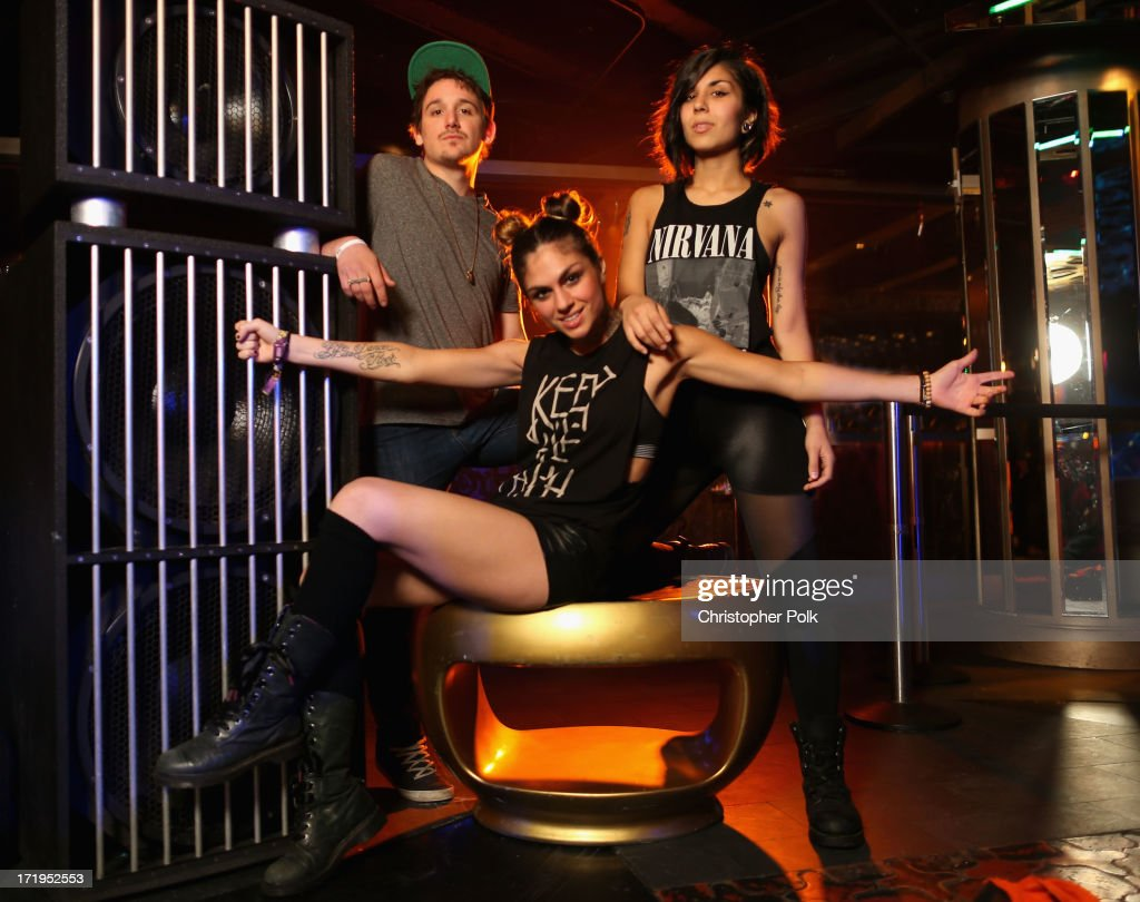 Kris 'Rain Man' Trindl, Jahan Yousaf and Yasmine Yousaf of Krewella pose in the Wonderwall Portrait Studio at the iHeartRadio Ultimate Pool Party Presented by VISIT FLORIDA at Fontainebleau's BleauLive in Miami featuring live performances by Pitbull, Ke$ha, Afrojack, Icona Pop, Krewella and Jason Derulo on June 29, 2013 in Miami Beach, Florida.