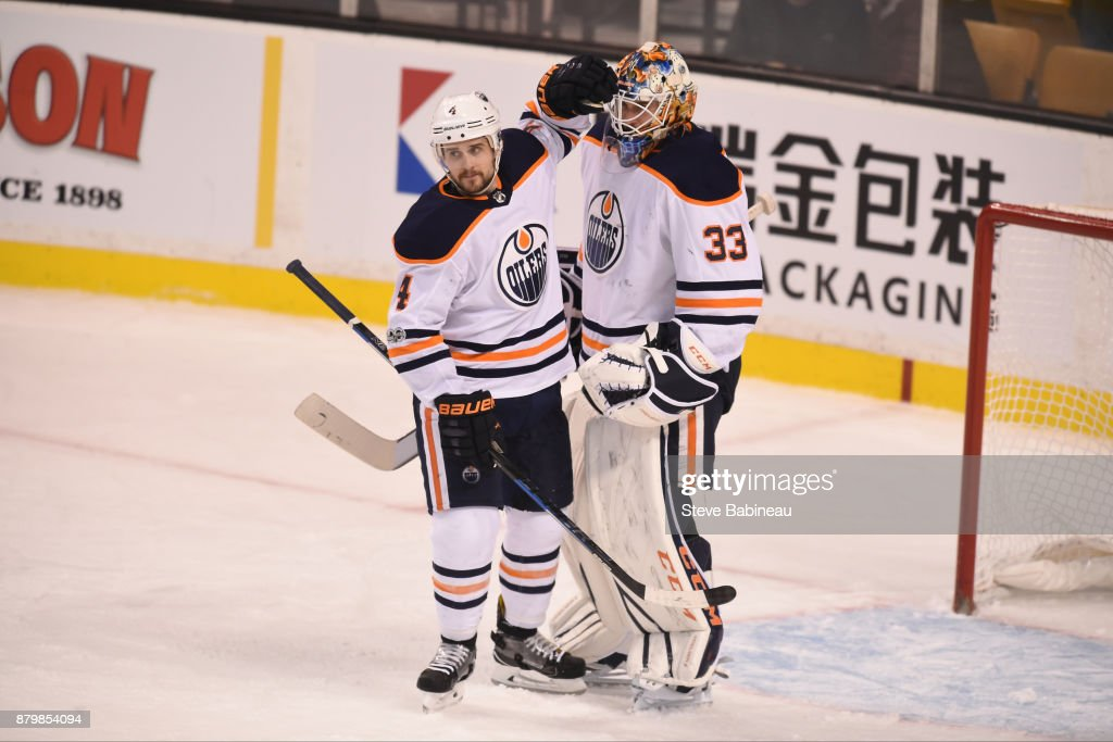 Kris Russell #4 and Cam Talbot #33 of the Edmonton Oilers celebrate a win against the Boston Bruins at the TD Garden on November 26, 2017 in Boston, Massachusetts.