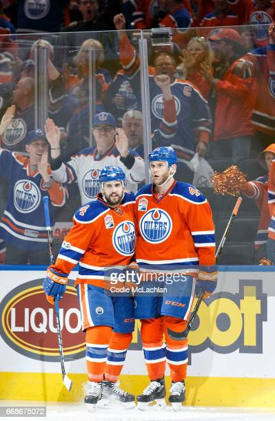 Kris Russell and Zack Kassian of the Edmonton Oilers celebrate Kassian's goal against the San Jose Sharks in Game Two of the Western Conference First...