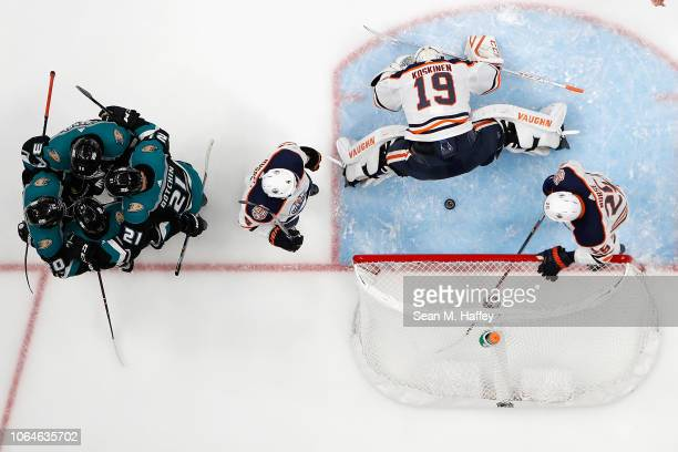Kris Russell Mikko Koskinen and Darnell Nurse of the Edmonton Oilers look on as Jake Dotchin Pontus Aberg Adam Henrique and Josh Manson of the...