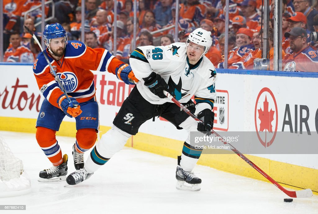 Kris Russell #4 of the Edmonton Oilers battles against Tomas Hertl #48 of the San Jose Sharks in Game One of the Western Conference First Round during the 2017 NHL Stanley Cup Playoffs at Rogers Place on April 12, 2017 in Edmonton, Alberta, Canada.