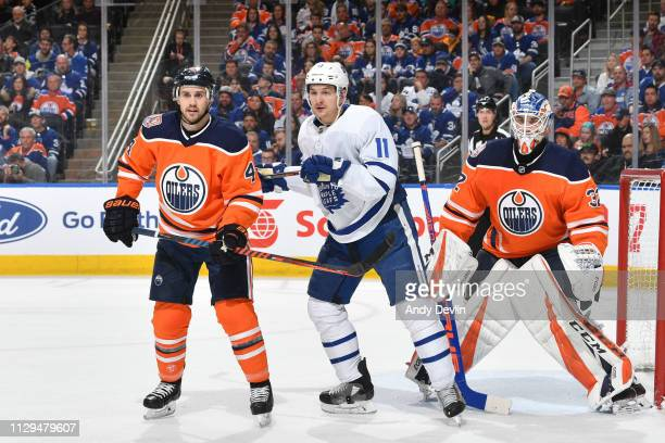 Kris Russell of the Edmonton Oilers battles for position against Zach Hyman of the Toronto Maple Leafs on March 9 2019 at Rogers Place in Edmonton...