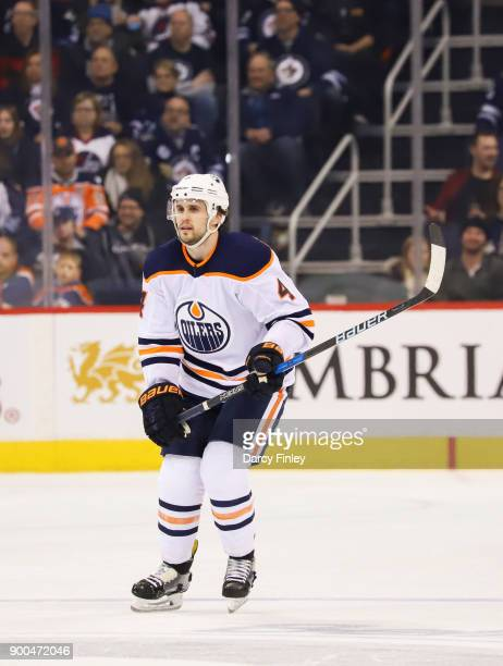 Kris Russell of the Edmonton Oilers follows the play up the ice during third period action against the Winnipeg Jets at the Bell MTS Place on...