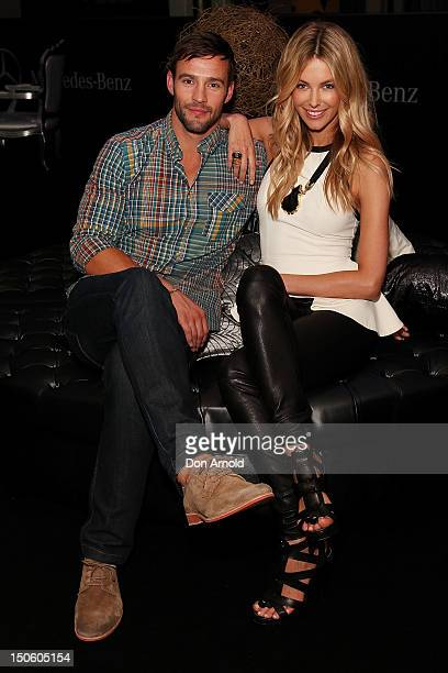 Kris Smith and Jennifer Hawkins pose backstage ahead of the MYER show as part of the MercedesBenz Fashion festival Sydney 2012 at Sydney Town Hall on...