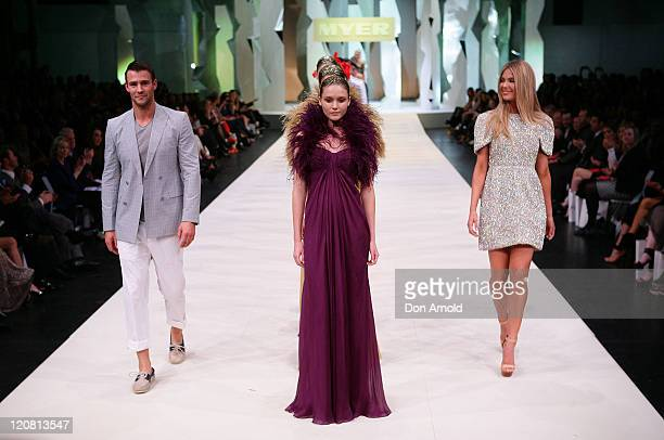 Kris Smith and Jennifer Hawkins showcase designs on the catwalk at the Myer Spring/Summer 2011 fashion launch on August 11, 2011 in Sydney, Australia.