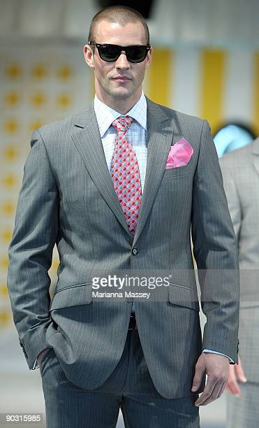 Kris Smith displays a design by Dom Bagnato at Flemington Racecourse for the Spring Carnival Fashion Lunch catwalk show on September 3, 2009 in...