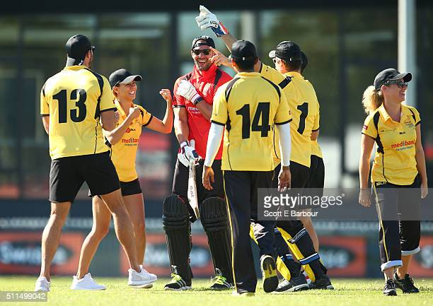 Kris Smith leaves the field after being dismissed as Glen Moriarty Lauren Phillips Sam Wood and Ash Pollard gesture towards him during the Medibank...