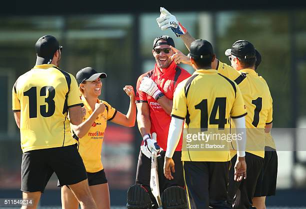 Kris Smith leaves the field after being dismissed as Glen Moriarty Lauren Phillips and Sam Wood gesture towards him during the Medibank Melbourne...