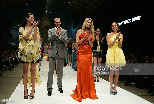 Kris Smith wearing designs by Dom Bagnato, Jennifer Hawkins showcases a design by Aurelio Costarella in the Finale at the MYER Spring Summer 2009/10...