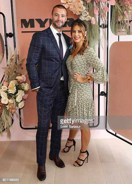 Kris Smith wearing Wolf Kanat and Lauren Phillips wearing Morrison and millinery by Eugenia Kim poses at the Myer Marquee on Stakes Day at Flemington...