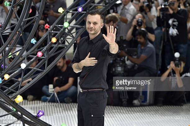 Kris Van Assche acknowledges the audience during the Dior Homme Menswear Spring/Summer 2017 show as part of Paris Fashion Week on June 25, 2016 in...