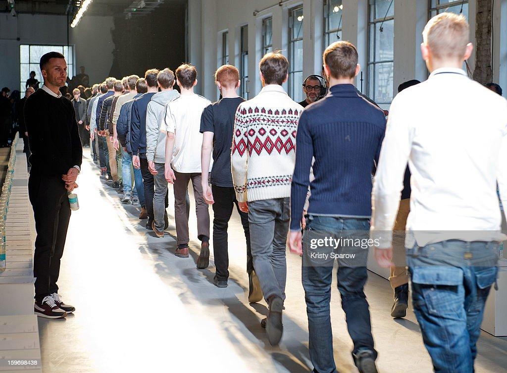 Kris Van Assche (L) is seen during the rehearsal walk through before the Krisvanassche Menswear Autumn / Winter 2013/14 show as part of Paris Fashion Week on January 18, 2013 in Paris, France.